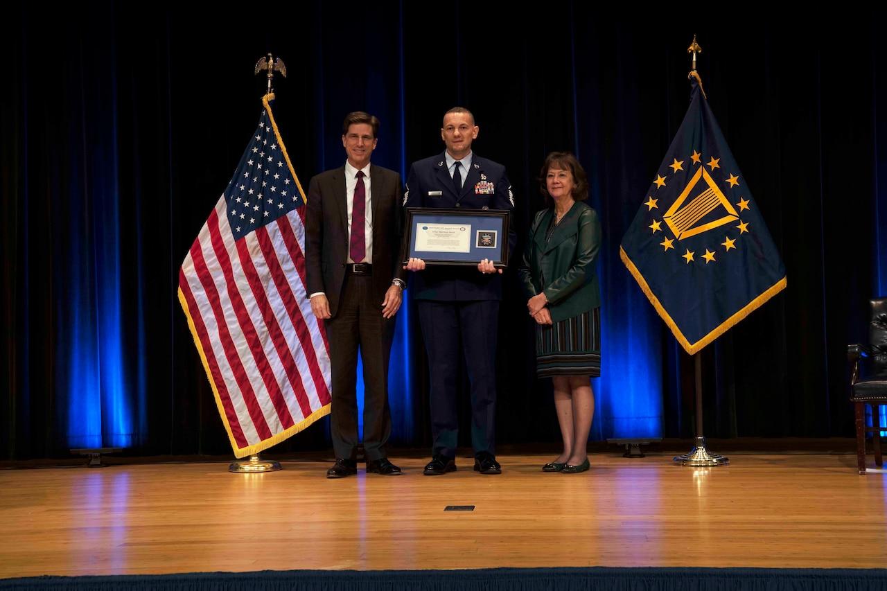 Air Force Master Sgt. Matthew Smith receives an award.