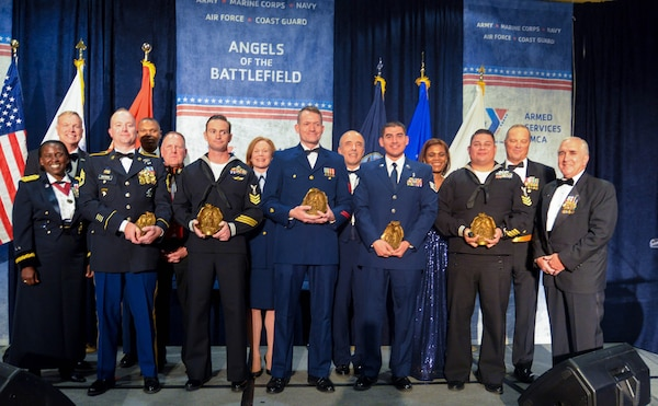 Recipients of the Angels of the Battlefield Awards Gala stand to receive their awards Oct. 29, 2019.