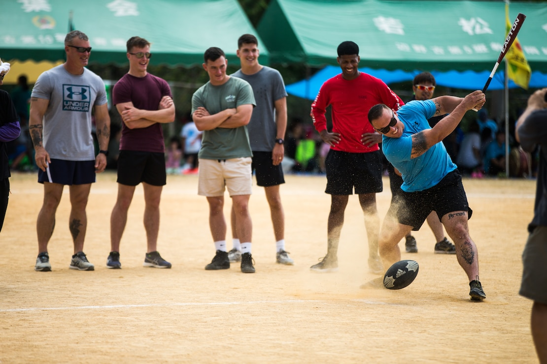 U.S. Marine Corps Staff Sgt. Garrett Burn, an engineer platoon sergeant with 4th Marine Regiment, 3rd Marine Division, participates in a rugby ball-handling relay competition during the 46th Annual Henoko District Citizen's Track and Field Meet Sports Day in Henoko, Okinawa, Japan, Nov. 3, 2019. Personnel from Camp Schwab have been included in the track and field meet since 1973 and will carry on the tradition of good will and togetherness with the people of Henoko.