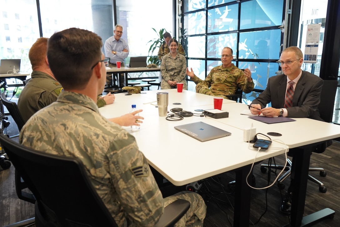 U.S. Air Force Maj. Rachel Ramirez, Senior Airman Jacob Traugott, Maj. Ivan Bohlender and Maj. Louis Bennett talk with Maj. Gen. Mark Weatherington, AETC deputy commander, about Project NEXUS before their graduation ceremony Nov. 4, 2019 at the Capital Factory in Austin, Texas. Designed by the AETC Integrated Technology Detachment and hosted by the AFWERX-Austin hub, the beta test program was designed to fuel organic technology problem solving efforts for Airmen in their day-to-day workplaces. (U.S. Air Force photo / Staff Sgt. Jordyn Fetter)