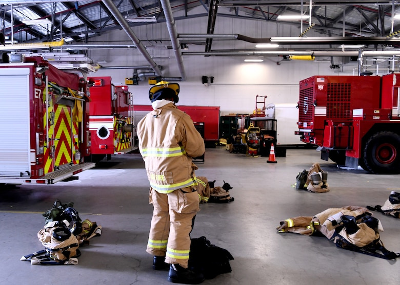 Firefighters from the 104 FW participate in fire prevention week on October 8, 2019. Staff Sgt. Sam Schrader, 104th firefighter puts on his gear. (U.S. Air National Guard photo by Airman Basic Camille Lienau)