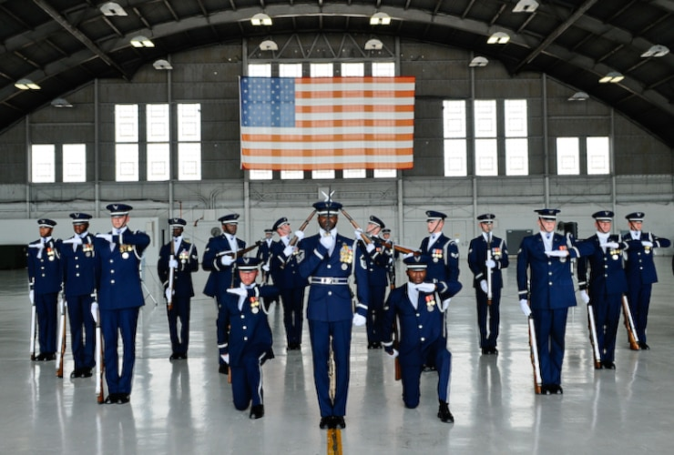 Photo of Air Honor Guard Drill Team performing inside a hangar