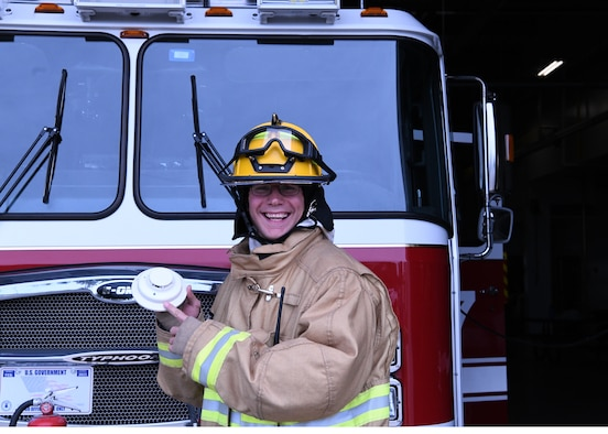 Firefighters from the 104 FW participate in fire prevention week on October 8, 2019. Staff Sgt. Sam Schrader a 104th firefighter,checks a smoke detector. According to the U.S. fire administration smoke detectors should be tested at least once a month and batteries should be replaced at least once or twice a year. (U.S. Air National Guard photo by Airman Basic Camille Lienau)