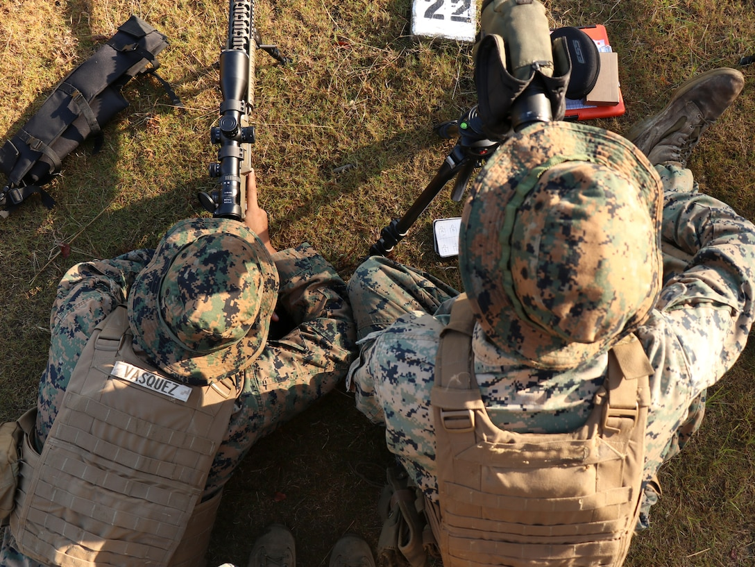 U.S. Marines assigned to Marine Corps Security Force Regiment participate in the unknown distance daytime course of fire during a Designated Marksmanship course Oct. 23, 2019, at Naval Weapons Station Yorktown, Yorktown, Virginia. The role of a Designated Marksman is to provide precision fire to the unit commander for Fleet Anti-terrorism Security Team companies and the Recapture Tactics Team. During the course, Marines learn basic designated marksman employment such as security posture, communications, multi-threat engagements, alternate shooting positions, as well as moving target, unknown distance, and limited visibility engagements.