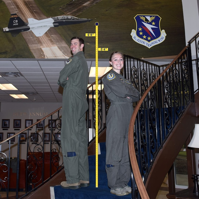 Two instructor pilots from the 14th Flying Training Wing at Columbus Air Force Base, Miss., stand side-by-side to illustrate the varying standing heights of Air Force pilots to dispel the myth that there is one height standard for all Air Force pilots.  Height waivers are available for candidates that do not meet AFI 48-123 standards. If you are interested in learning more about height waivers, work with your commission source or contact the Air Force Call Center at 1-800-423-USAF. (U.S. Air Force courtesy photo)