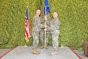 Lt. Col. Rodney E. McCraine, left, 403rd Mission Support Group commander, presents the guidon to Lt. Col. Jeffrey L. Frye, 41st Aerial Port Squadron commander, during the Assumption of Command ceremony of 41st Aerial Port Squadron at Keesler Air Force Base, Miss., Nov. 2. The 41st Aerial Port Squadron processes personnel and cargo to include rigging for airdrop, packing parachutes, loading equipment, and preparing air cargo and load plans. The 41st APS is assigned to the Air Force Reserve's 403rd Mission Support Group. (U.S. Air Force photo by Tech. Sgt. Michael Farrar)