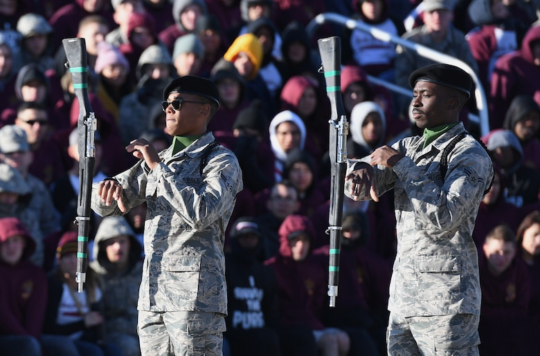 U.S. Air Force Airmen 1st Class Camron Richardson and Abdulahi Alausa, 334th Training Squadron freestyle drill team members, perform during the 81st Training Group drill down on the Levitow Training Support Facility drill pad at Keesler Air Force Base, Mississippi, Nov. 1, 2019. Airmen from the 81st TRG competed in a quarterly open ranks inspection, regulation drill routine and freestyle drill routine. Keesler trains more than 30,000 students each year. While in training, Airmen are given the opportunity to volunteer to learn and execute drill down routines. (U.S. Air Force photo by Kemberly Groue)