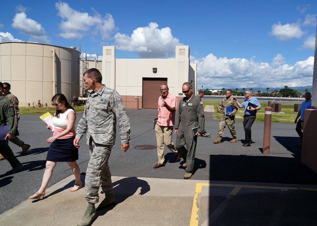 Retired Gen. Raymond E. Johns, National Commission on Military Aviation Safety Commissioner, speaks with Col. Halsey Burks, 15th Wing Commander, at Joint Base Pearl Harbor-Hickam, Hawaii, Nov. 1, 2019. The group spoke with senior and junior Airmen to learn more about military aviation safety in order to address previous mishaps across the Department of Defense. The visit to Hickam was significant due to the active duty and guard Total Force Integration of Hickam Airfield. (U.S. Air Force photo by Airman 1st Class Erin Baxter)