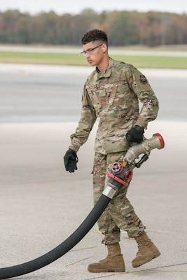 Airman Michael Morton, 436th Logistics Readiness Squadron fuels distribution operator, disconnects a fuel hose from a C-5 Galaxy after refueling is complete, Oct. 29, 2019, at Dover Air Force Base, Del. Refueling can last anywhere from a few minutes to a few hours. (U.S. Air Force photo by Mauricio Campino)