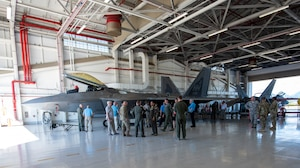 Members of the National Commission on Military Aviation Safety (NCMAS) take a tour of the F-22 Raptor facility Nov. 1, 2019, at Joint Base Pearl Harbor-Hickam. The purpose of NCMAS is to examine past mishaps and make recommendations to the President, Congress and ultimately the Defense Department on ways to improve aviation safety and readiness in the military. As part of their review, members of NCMAS conducted site visits of various flight facilities and operations located on Oahu island. (U.S. Air National Guard photo by Tech. Sgt. Alison Bruce-Maldonado)