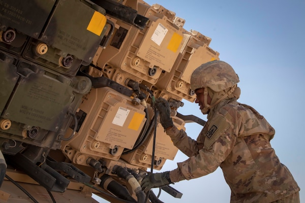 U.S. Army Pfc. Maya Richardson, a Patriot Launching Station Enhanced Operator-Maintainer assigned to Charlie Battery, 3rd Battalion, 4th Air Defense Artillery, 108th Air Defense Artillery Brigade, inspects the cables to her assigned MIM-104 Patriot missile system.