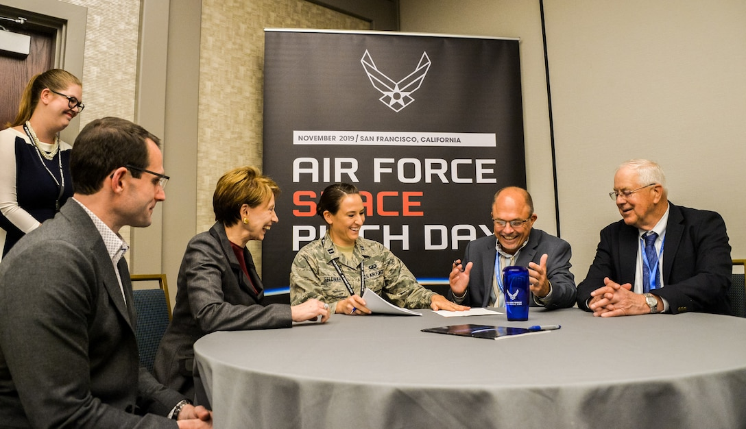 Dr. William Roper, Assistant Secretary of the Air Force for Acquisition, and Secretary of the Air Force Barbara Barrett witness the first contract signing of Air Force Space Pitch Day, Nov. 5, 2019, San Francisco, Calif. Air Force Space Pitch Day is a two-day event hosted by the Air Force to demonstrate the Air Force's willingness and ability to work with non-traditional startups. (U.S. Air Force photo by Van De Ha)