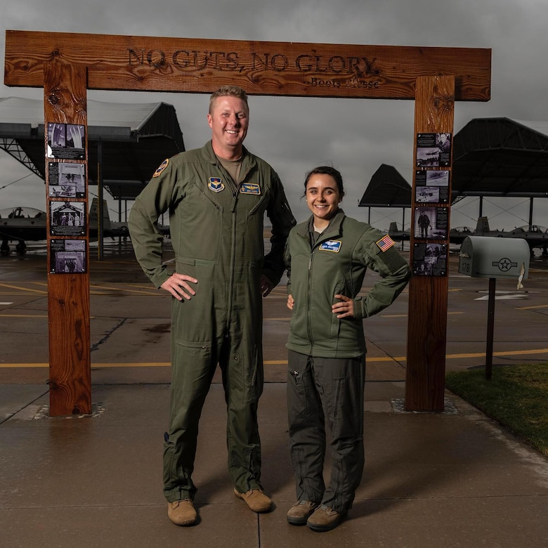 U.S. Air Force Maj. Nick Harris (left) and Capt. Jessica Wallander, instructor pilots with the 71st Flying Training Wing at Vance Air Force Base, Okla., stand side-by-side to illustrate the varying standing heights of Air Force pilots to dispel the myth that there is one height standard for all Air Force pilots.  Height waivers are available for candidates that do not meet AFI 48-123 standards.  If you are interested in learning more about height waivers, work with your commission source or contact the Air Force Call Center at 1-800-423-USAF. (U.S. Air Force Courtesy Photo)