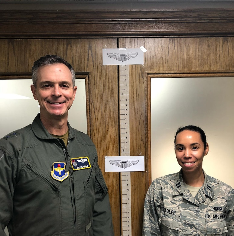 Maj. Gen. Craig Wills, 19th Air Force commander, stands side-by-side with a 19th Air Force pilot to illustrate the varying standing heights of Air Force pilots to dispel the myth that there is one height standard for all Air Force pilots.  Height waivers are available for candidates that do not meet AFI 48-123 standards. If you are interested in learning more about height waivers, work with your commission source or contact the Air Force Call Center at 1-800-423-USAF. (U.S. Air Force courtesy photo)