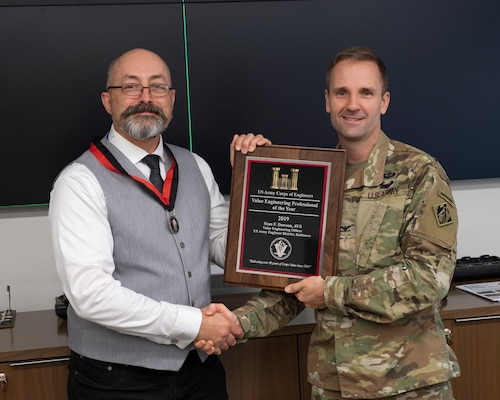 Col. John Litz, Baltimore District commander, presents Sean Dawson, Baltimore District value engineer, with the U.S. Army Corps of Engineers 2019 Value Engineer Professional of the Year award at the Baltimore District headquarters, Sept. 11, 2019. (U.S. Army photo by John Sokolowski)