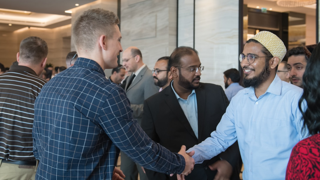 U.S. Air Force 1st Lt. Gavin McHenry, 386th Expeditionary Contracting Squadron base operations support flight commander and Air Force contract augmentation program administrative officer, shakes hands with an attendee at the Discover America week business speakers seminar at the Hyatt Regency Hotel in Kuwait City, Nov. 4, 2019. Airmen with the 386th ECONS discussed contract opportunities to local vendors. (U.S. Air Force photo by Tech. Sgt. Daniel Martinez)