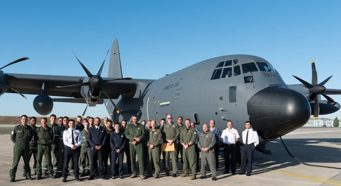 A group of Airmen from the Air Force Air Mobility Command and French Air Force pause for a photo in front of a KC-130J aircraft that was delivered to Évreux-Fauville Air Base, France Sept. 17, 2019. (Courtesy photo)