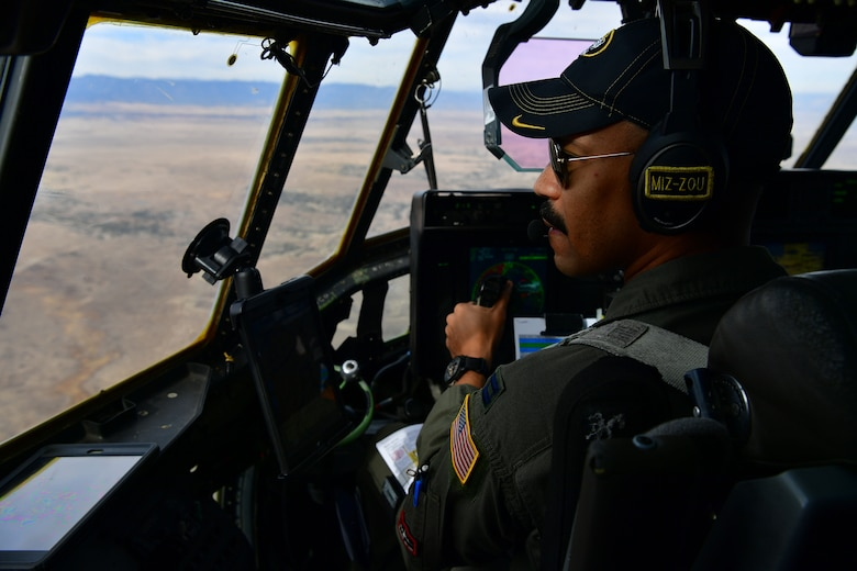 A student pilot looks out the window of a C-130 Hercules.