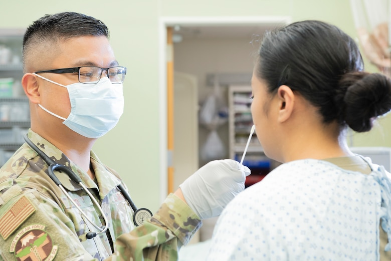 Capt. Rupert Laco, 374th Medical Operations Squadron emergency services flight commander, administers a rapid flu test to a patient, Nov. 4, 2019, at Yokota Air Base, Japan.