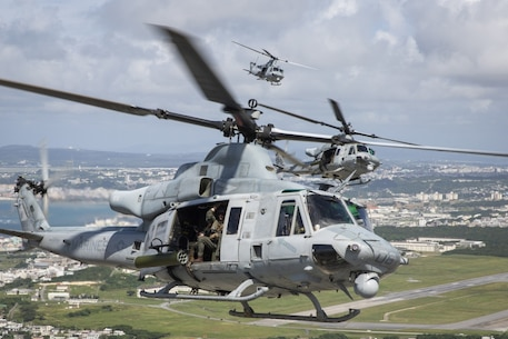 U.S. Marine Corps UH-1Y Huey helicopters with Marine Light Attack Helicopter Squadron 169 currently attached to 1st Marine Aircraft Wing, III Marine Expeditionary Force, fly in a formation during a rapid deployment exercise conducted by 1st MAW, Oct. 24 in Okinawa, Japan.