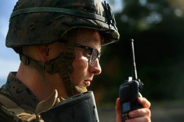 U.S. Marine Corps Cpl. William Testorff with Headquarters Battalion, 3rd Marine Division, performs a radio check while on patrol during Samurai 20-1 on Camp Hansen, Okinawa, Japan, Oct. 22, 2019.