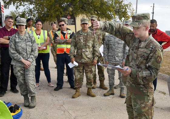 An image of Airmen receiving a safety briefing during a CBRNE exercise