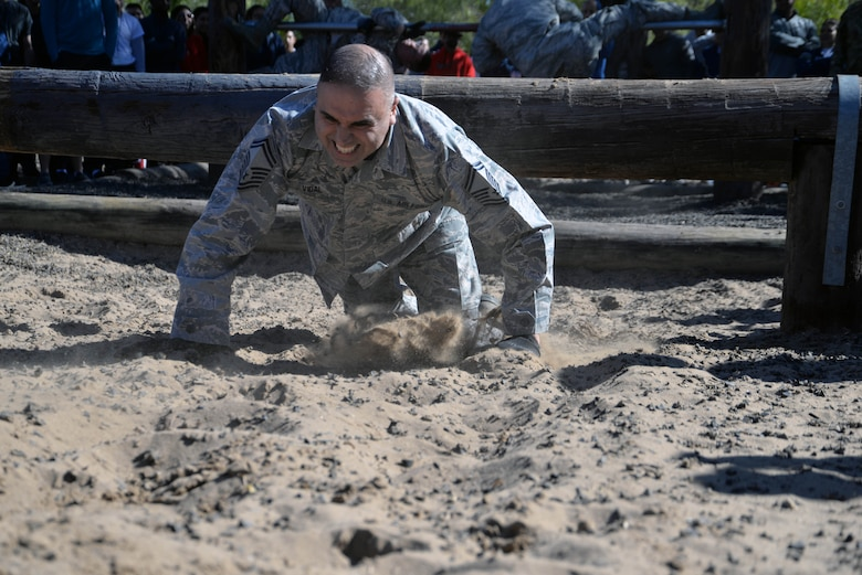 Senior Master Sgt. Leonard E. Vidal, 433rd Maintenance Group plans and schedule supervisor, high-crawls through sand during a team-building exercise at the 433rd AW Resilience Tactical Pause at the Air Force Basic Military Training's Basic Expeditionary Airman Skills Training site at the Medina Annex, Joint Base San Antonio-Lackland, Texas Nov. 3, 2019.