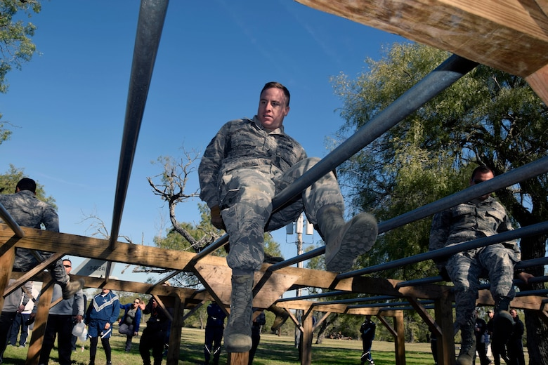 Staff Sgt. Bradley A. Hanks, 433rd Security Forces Squadron, crawls across an obstacle during a team-building exercise at the 433rd AW Resilience Tactical Pause at the Air Force Basic Military Training's Basic Expeditionary Airman Skills Training site at the Medina Annex, Joint Base San Antonio-Lackland, Texas Nov. 3, 2019.