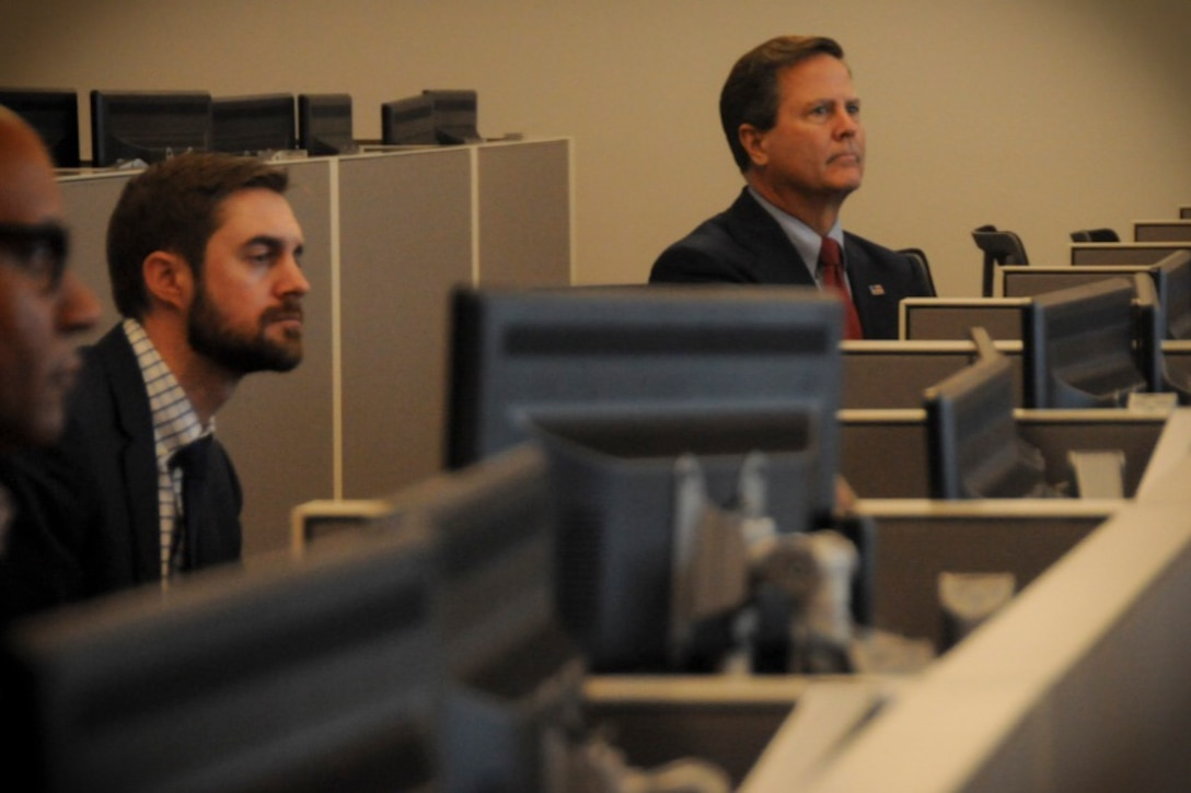 U. S. Congressman Donald Norcross of the 1st district of New Jersey listens during a presentation from the 140th Cyber Operations Squadron at Joint Base McGuire-Dix-Lakehurst, N.J., Nov. 1, 2019. Norcross toured the 140th COS's building. (U.S. Air National Guard photo by Airman 1st Class Andrea A. S. Williamson)