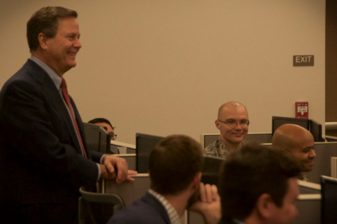 U. S. Congressman Donald Norcross of the 1st district of New Jersey laughs while conversing with Airmen from the 140th Cyber Operations Squadron at Joint Base McGuire-Dix-Lakehurst, N.J., Nov. 1, 2019. Norcross toured the 140th COS's building. (U.S. Air National Guard photo by Airman 1st Class Andrea A. S. Williamson)