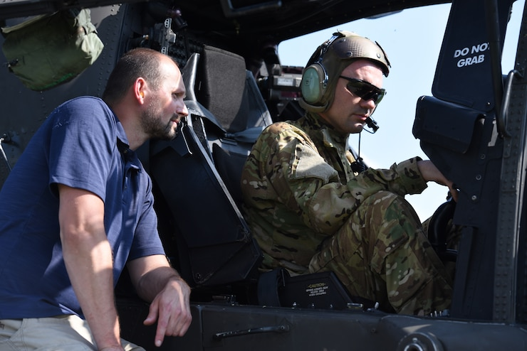 Krizyztoff Bernecki fro LRC - Aviation assists Sgt. Igor Burliai from 1-2 Attack Reconnaissance Battalion, 12th Combat Aviation Brigade do a AH-64D Apache radar warning equipment test during exercise Saber Guardian 19 in Solznok, Hungary.