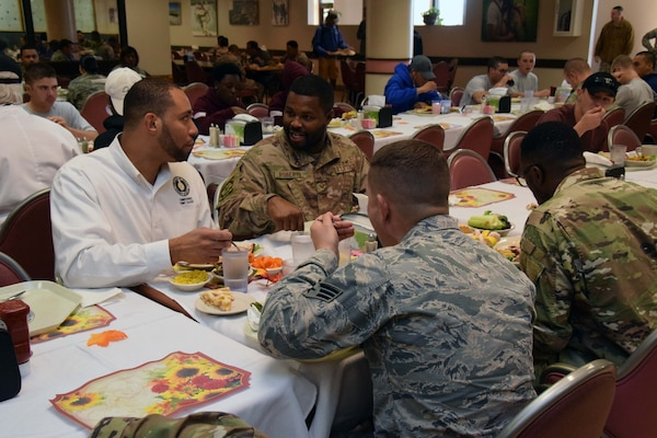Bexar County Commissioner Tommy Calvert, Precinct 4, fellowships with 433rd Airlift Wing Reserve Citizen Airmen after serving the Airmen a Thanksgiving feast, at the Live Oak Dining Facility, Joint Base San Antonio-Lackland, Texas Nov. 2, 2019.