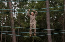 A recruit with Lima Company, 3rd Recruit Training Battalion, uses a rope to cross over a water obstacle on the Confidence Course on Marine Corps Recruit Depot Parris Island, S.C. Oct. 30, 2019. The Confidence Course is composed of various obstacles that both physically and mentally challenge recruits. (U.S. Marine Corps photo by LCpl. Michelle Brudnicki)