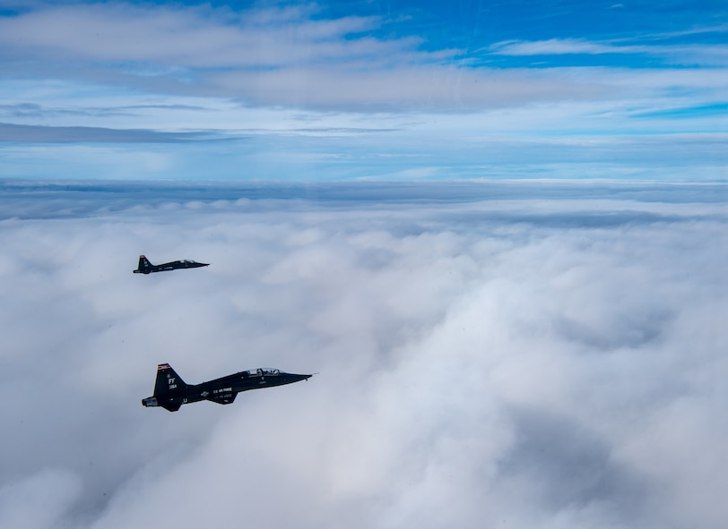 U.S. Air Force T-38 Talons from the 1st Fighter Wing fly in formation of the Atlantic Ocean during training off the coast of Virginia, Oct. 30, 2019. The 1st Fighter Wing is home to the 94th Fighter Squadron, 27th Fighter Squadron and the 71st Fighter Training Squadron at Joint Base Langley-Eustis, Va. (U.S. Air Force Photo by Tech Sgt. Carlin Leslie)(Released)