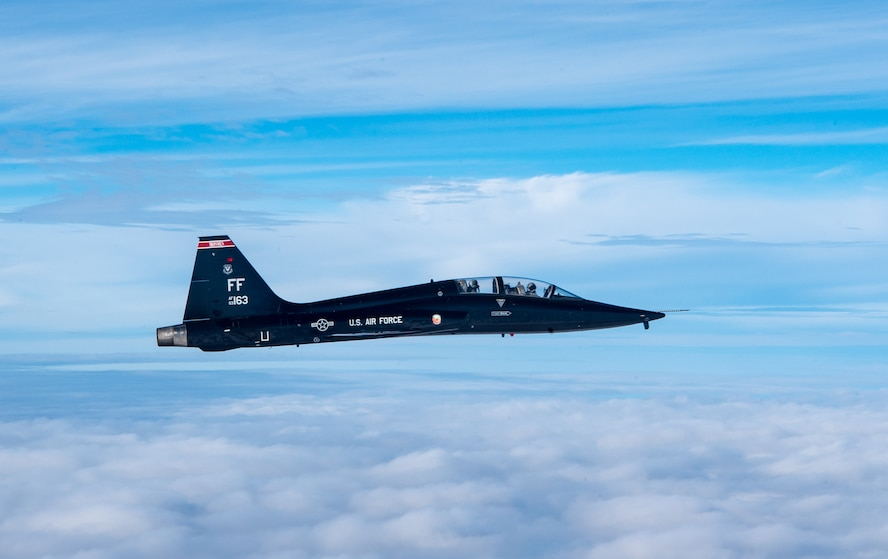 A U.S. Air Force T-38 Talons from the 1st Fighter Wing flies over the Atlantic Ocean during training off the coast of Virginia, Oct. 30, 2019. The 1st Fighter Wing is home to the 94th Fighter Squadron, 27th Fighter Squadron and the 71st Fighter Training Squadron at Joint Base Langley-Eustis, Va. (U.S. Air Force Photo by Tech Sgt. Carlin Leslie)(Released)