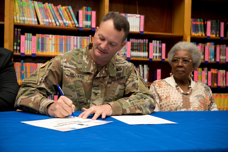 U.S. Army Corps of Engineers Vicksburg District Commander Col. Robert A. Hilliard signs an adoption certificate Nov. 4 Beechwood Elementary School in Vicksburg, Mississippi, securing a partnership with the school and the district for the 2019-2020 school year.