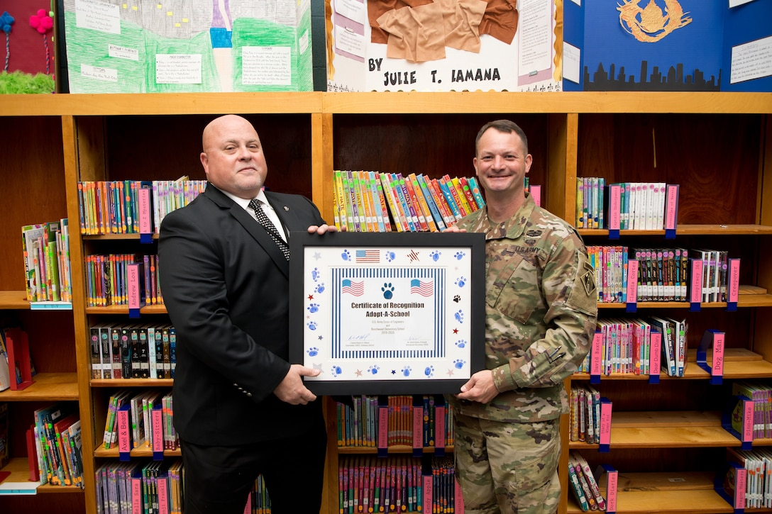 U.S. Army Corps of Engineers (USACE) Vicksburg District Commander Col. Robert A. Hilliard and Beechwood Elementary School principal David Adams hold an adoption certificate Nov. 4 at Beechwood Elementary School in Vicksburg, Mississippi.