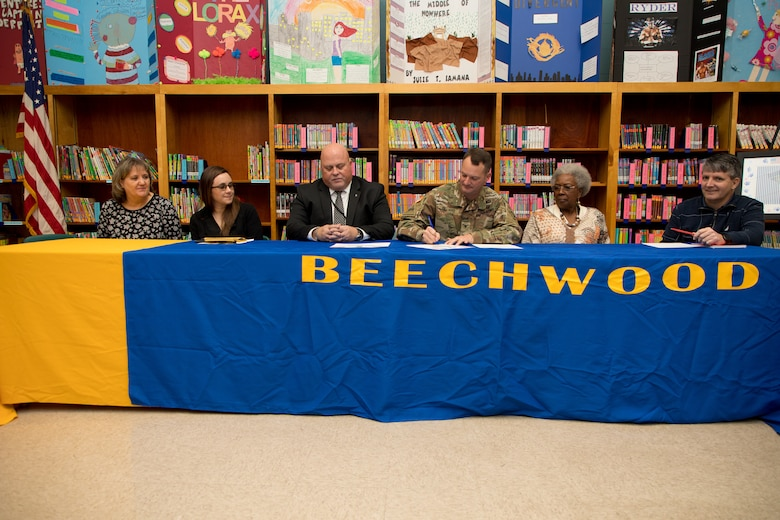 U.S. Army Corps of Engineers (USACE) Vicksburg District Commander Col. Robert A. Hilliard and Beechwood Elementary School principal David Adams sign an adoption certificate Nov. 4 at Beechwood Elementary School in Vicksburg, Mississippi, securing the 2019-2020 adopt-a-school partnership between the district and the school.