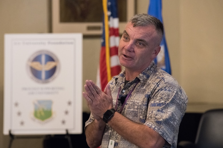 Mr./Colonel (Retired) Rob Swanson delivering A Story of Inspiration at the Air University Suicide Awareness Summit. (U.S. Air Force photo by William Birchfield)