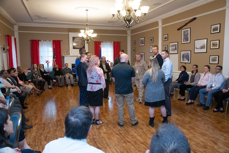 Attendees and speakers of the Air University Suicide Awareness Summit participate in a group exercise, Oct. 30, 2019, Maxwell Air Force Base, Alabama.