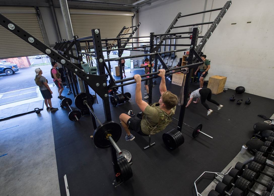 Service members of the 786th Civil Engineer Squadron explosive ordnance disposal flight participate in the 136 memorial workout at Ramstein Air Base, Germany, Nov. 5, 2019.