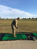 U.S. Air Force Captain Ryan Boothe, a psychiatric mental health nurse practitioner assigned to the 509th Operational Medical Readiness Squadron, learns how to golf during the inaugural Kick Back Day event at Royal Oaks Golf Course, Missouri, Nov. 1, 2019. Whiteman Top III held the wing event to help Airmen de-stress, learn a new skill and meet new people after a busy exercise season. (U.S Air Force photo by Chelsea Ecklebe)