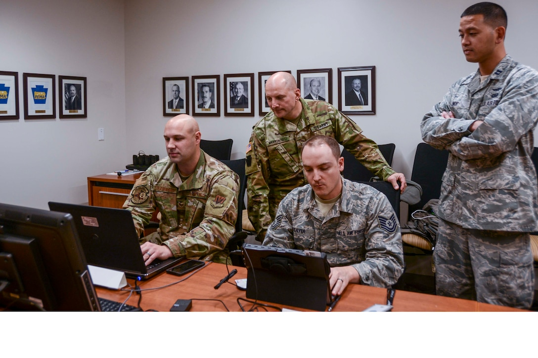 About 30 members of the Pennsylvania National Guard joined state agencies at three locations Nov. 5 to ensure the security of the commonwealth's general election. A team at the Pennsylvania Emergency Management Agency (above) focused on network monitoring, while teams at Fort Indiantown Gap and Horsham Air Guard Station focused on social media reporting.