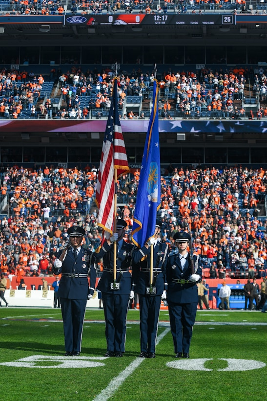Buckley Air Force Base Mile High honor guardsmen prepare to present the colors before the Denver Broncos Salute to Service game at Empower Field at Mile High in Denver, Nov. 3, 2019.