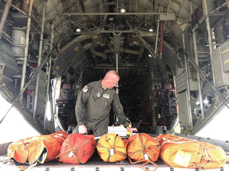 Tech. Sgt. Pat Englishby, 39th Rescue Squadron Load Master prepares the HC-130N Combat King aircraft to respond to the combined federal, Department of Defense, state and local rescue mission for a missing Airman in the Gulf of Mexico November 6, 2019. (U.S. Air Force video by Tech. Sgt. Kelly Goonan)