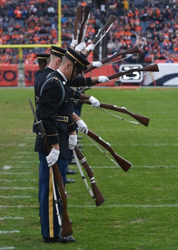 The U.S. Army Drill Team performs during the halftime show for the Denver Broncos Salute to Service game at Empower Field at Mile High in Denver, Nov. 3, 2019.