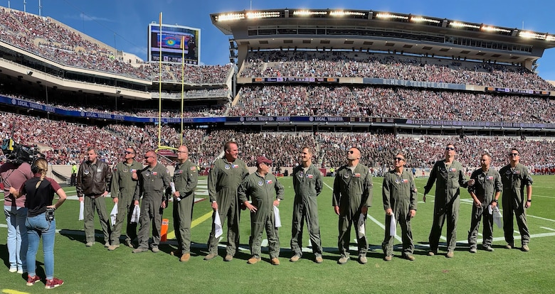 Air crews stands on Kyle Field during their recognition for the pregame flyover for Texas A&M.