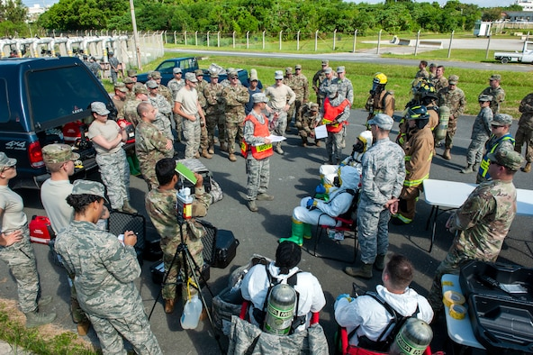 U.S. Air Force Master Sgt. Kyle Rollins, 18th Civil Engineer Squadron assistant chief of operations, gives a safety brief during a fuel spill exercise at Kadena Air Base, Japan, Oct. 25, 2019. This exercise gave Airmen the opportunity to hone emergency response and informed base leadership on the importance of developing and implementing a solid fuel spill prevention plan. (U.S. Air Force photo by Naoto Anazawa)
