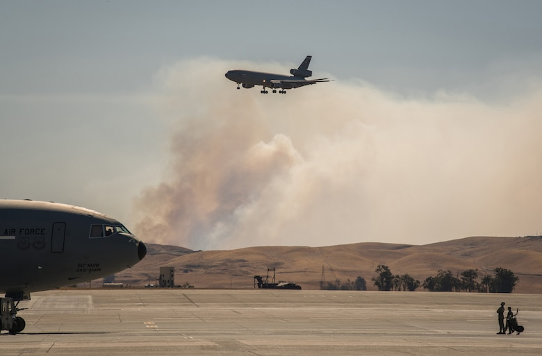 Photos of California Wildfires burn outside of Travis AFB