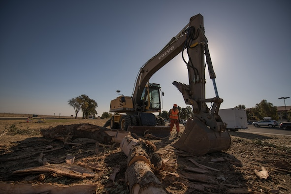 Photos of Travis Airmen cleaning the base of debris.